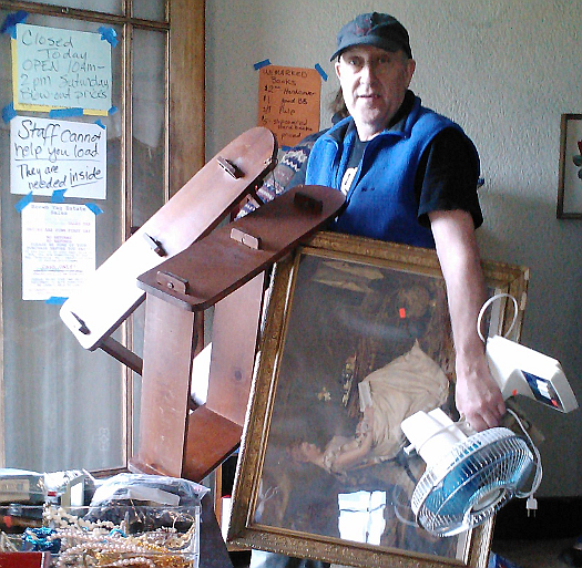 man carrying estate sale items.