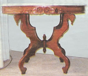 A reproduction of a Victorian style table